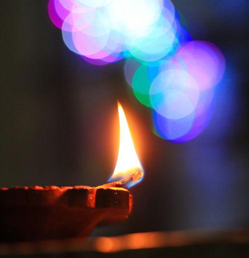 Flame Burning Heat - Temperature Glowing Fire Illuminated Fire - Natural Phenomenon Close-up No People Nature Lighting Equipment Indoors  Focus On Foreground Lens Flare Light - Natural Phenomenon Oil Lamp Celebration Diya - Oil Lamp Religion Electric Lamp Luminosity