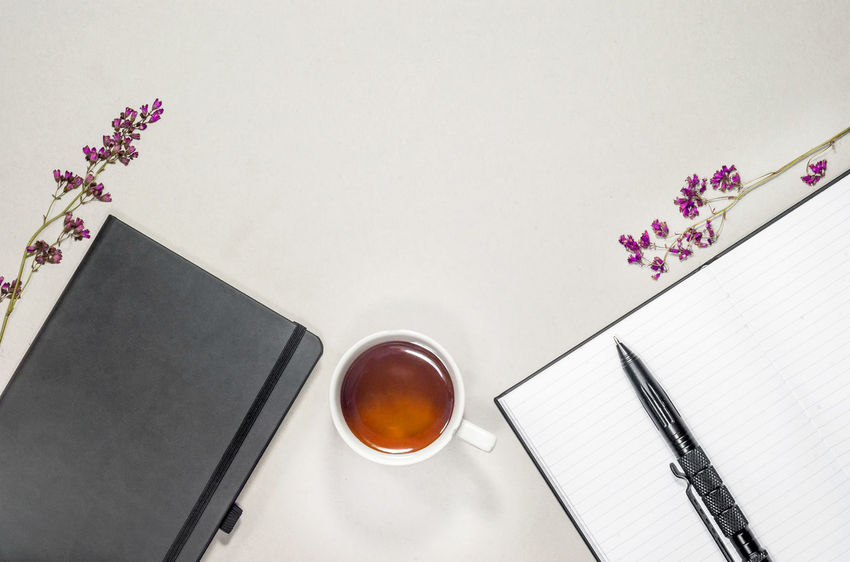 Book Coffee - Drink Crockery Cup Directly Above Drink Flower Flowering Plant Food And Drink Freshness Glass High Angle View Hot Drink Indoors  Mug No People Paper Pen Plant Publication Refreshment Still Life Table Tea Cup