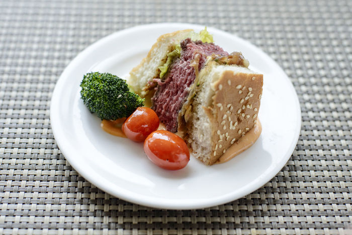 Part of a giant Beef Burger Beef Burger Broccoli Close-up Day Food Food And Drink Freshness Healthy Eating Indoors  No People Plate Ready-to-eat Serving Size