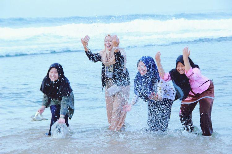 Friends enjoying at beach