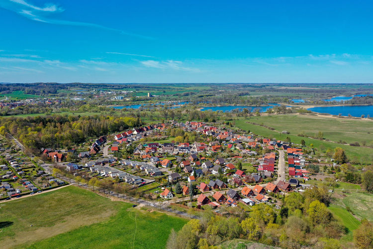 Aerial view of houses in a small town - aerial landscape Village Town Aerial Photography Aerial Landscape Sky Aerial Shot Residential District Flower Water Sea Beach Sky Horizon Over Water Landscape Poppy Patchwork Landscape Place Neighborhood TOWNSCAPE Tiled Roof  View Into Land Topography