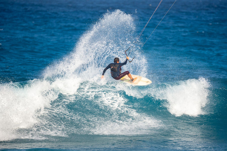 Sea Water Motion Sport Surfing Aquatic Sport Wave One Person Adventure Splashing Men Leisure Activity Nature Day Extreme Sports Speed Surfboard Lifestyles Outdoors Kiteboarding