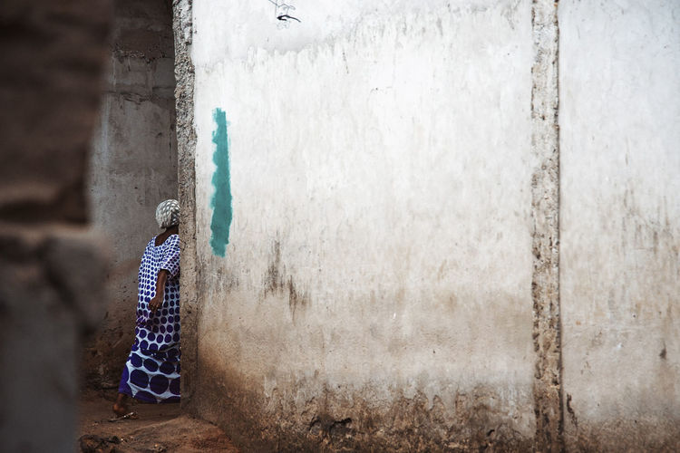 Street Photography Slum Black Woman Wall - Building Feature Traditional Clothing Architecture One Person Women Built Structure Day Adult Real People Rear View Lifestyles Outdoors Building Exterior Weathered Wall Standing Full Length Walking Clothing Concrete