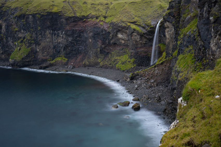 EyeEm Nature Lover Tadaa Community Beauty In Nature Day Environment Faroe Islands Flowing Flowing Water Land Long Exposure Motion Mountain Nature No People Outdoors River Rock Rock - Object Scenics - Nature Solid Tranquil Scene Tranquility Water Waterfall