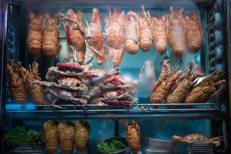 Seafood displayed in refrigerator at fish market