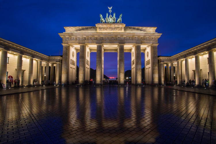 Low Angle View Of Illuminated Brandenburg Gate Against Sky