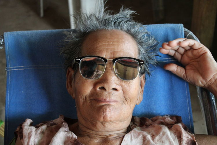 Portrait of woman in sunglasses at home