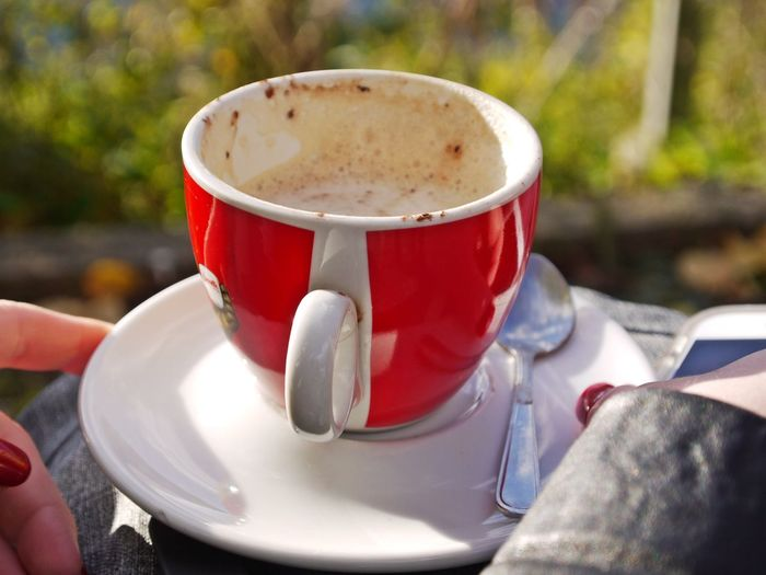 Spoon Close-up Coffee - Drink Coffee Cup Day Drink Focus On Foreground Food Food And Drink Freshness Frothy Drink Holding Human Body Part Human Hand One Person Outdoors People Real People Red Red Nail Refreshment Saucer