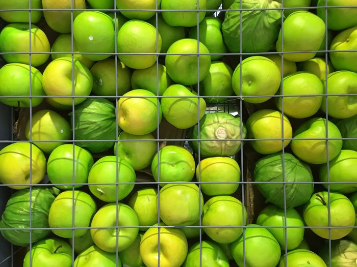 Full Frame Shot Of Green Apples And Cabbages