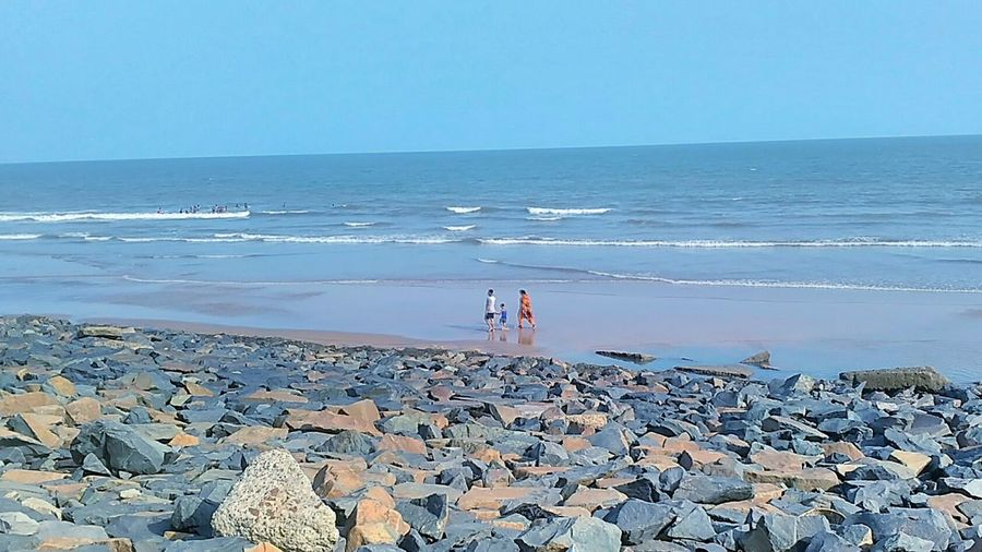Beach Sea Horizon Over Water Water Day People Outdoors Sky Nature Beauty In Nature Family Child Parents Seaside EyeEm Diversity Nature Photography Digha India ASIA Childhood Enjoying Life Mobile Photography Rocks