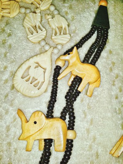 Figures Wolf Horse Dog Totem Shapes And Forms Craft Strand Contrasting Colors Textures And Patterns Camel Animals Wooden Beads Carved High Angle View Close-up Elephant