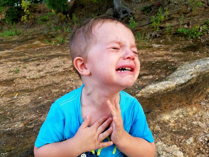 Close-up of boy crying outdoors