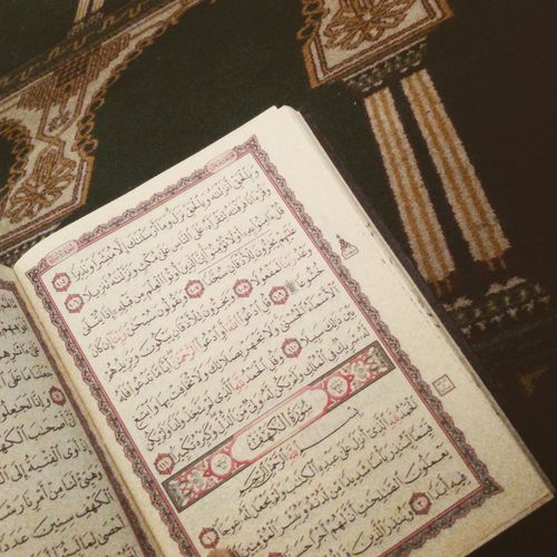 Muslim Woman Qur'an Relaxing