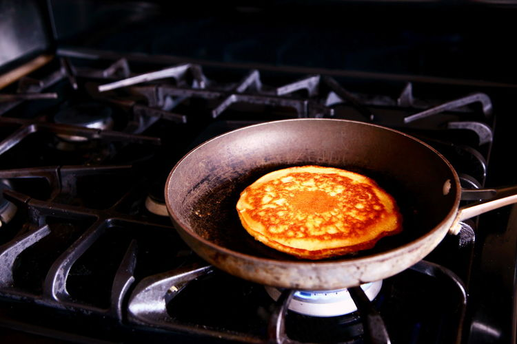 Close-up of pan cake being cooked on pan