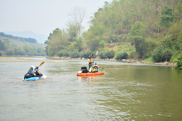 Water Outdoors Chiang Rai, Thailand Nautical Vessel Transportation Group Of People Adventure Men River Day Tree Safety Plant Leisure Activity Nature Oar People Waterfront Togetherness Sport Lifestyles Inflatable
