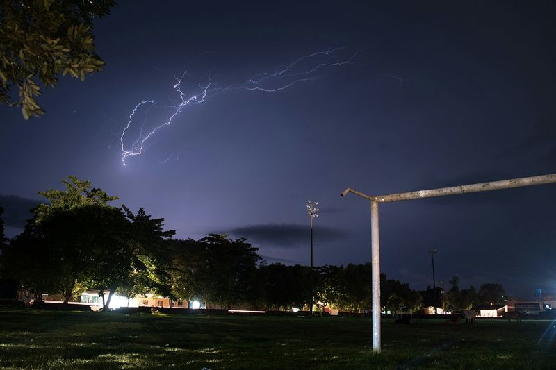 Night Tree No People Sky Playing Field Outdoors Beauty In Nature Soccer Field Lightning Nature City Astronomy