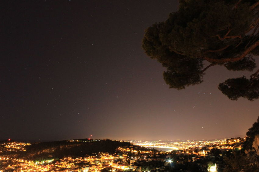 Architecture Astronomy Beauty In Nature Building Exterior City Cityscape Galaxy Illuminated La Baie Des Anges Luminosity Moon Nature Nice France Night No People Outdoors Scenics Sky Star - Space Tree