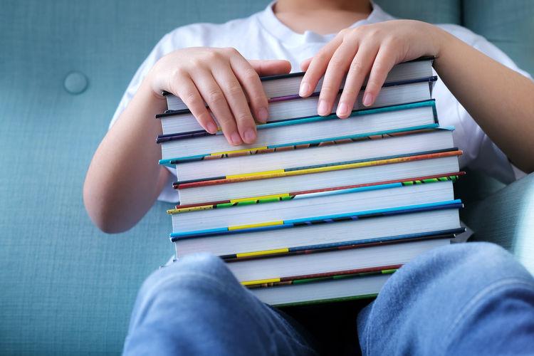 Full length of man reading book