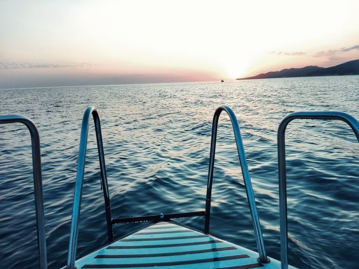 m y s e a ❤ Sea Water Sunset Sky Horizon Over Water Tranquility Sunlight Scenics Nature Summer Outdoors No People Travel Beauty In Nature Nautical Vessel Vacations Day Blue Clear Sky