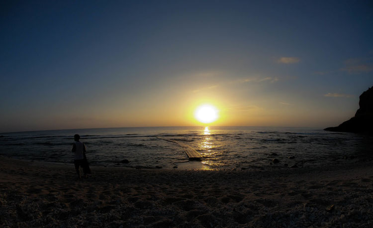 Taiwan Beach Beauty In Nature Day Greenisland Horizon Over Water Idyllic Leisure Activity One Person Outdoors Real People Sand Scenics Sea Shore Silhouette Sky Standing Sun Sunlight Sunset Tranquil Scene Tranquility Vacations Wave