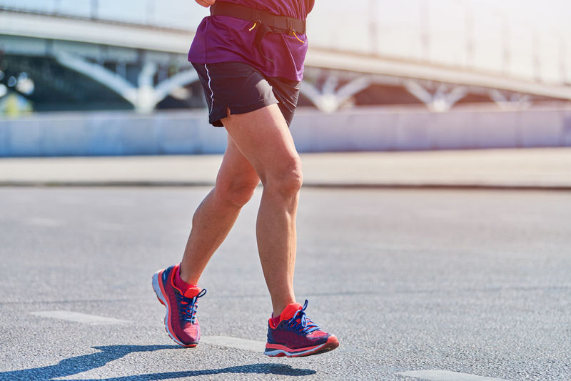 Low section of woman running