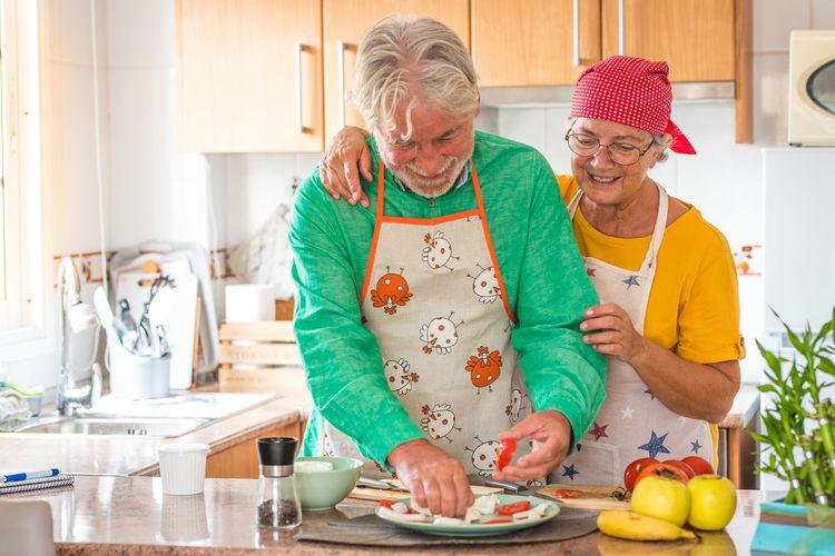 Full length of a woman preparing food at home