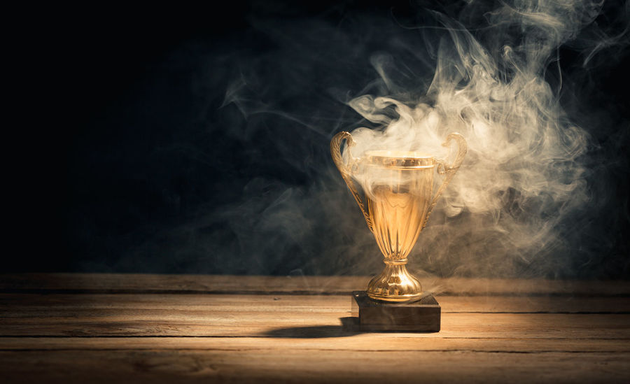 Achievement Awards First Hot Leader Smoke Smoking Trophy Waiting Burning Competition Cup Distant Emitting Fire Leadership Mist Reward Sports Steam Still Life Table Winner