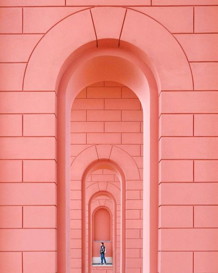 EyeEm Best Shots EyeEm Gallery Eye4photography  The Week on EyeEm Architectural Column One Person EyeEm Selects One Man Only Shadows & Lights Shadow Pastel Futuristic Arch Red Pink Color Pattern Architecture Built Structure Archway Passage Open Door Historic Building Entrance Gate Brick Wall Brick