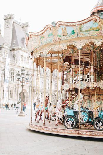 Paris Paris Carousel Amusement Park Amusement Park Ride Architecture Arts Culture And Entertainment Carousel Horses Merry-go-round City Tourism Group Of People Representation Art And Craft People Building Exterior Travel Destinations Incidental People Travel Outdoors