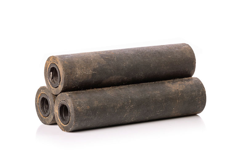 Close-up of old metal against white background