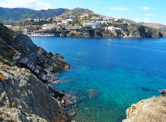 Landscape of the city and coast in Cerbere, France Cerbere City European  France Mediterranean  Pyrenees Touristic Travel Beach Blue Cliff Europe Mountain Nature Occitanie Ocean Outdoors Picturesque Pyrénéesorientales Scenics Sea Tourism Town Village Water