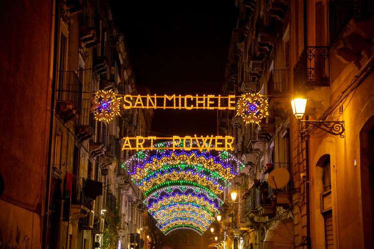 Italy Sicily Illuminated Night Architecture Built Structure Lighting Equipment Building Exterior Low Angle View Decoration Building City No People Hanging Celebration Text Street Outdoors Communication Christmas Holiday Entrance