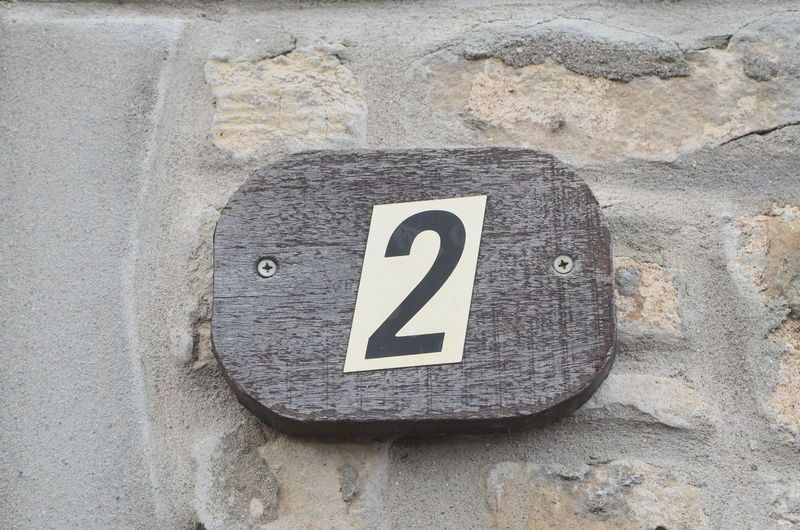 number two Number No People High Angle View Textured  Close-up Communication Wall - Building Feature Sign Building Exterior City Life Numbers And Signs Numbers Numbers Only