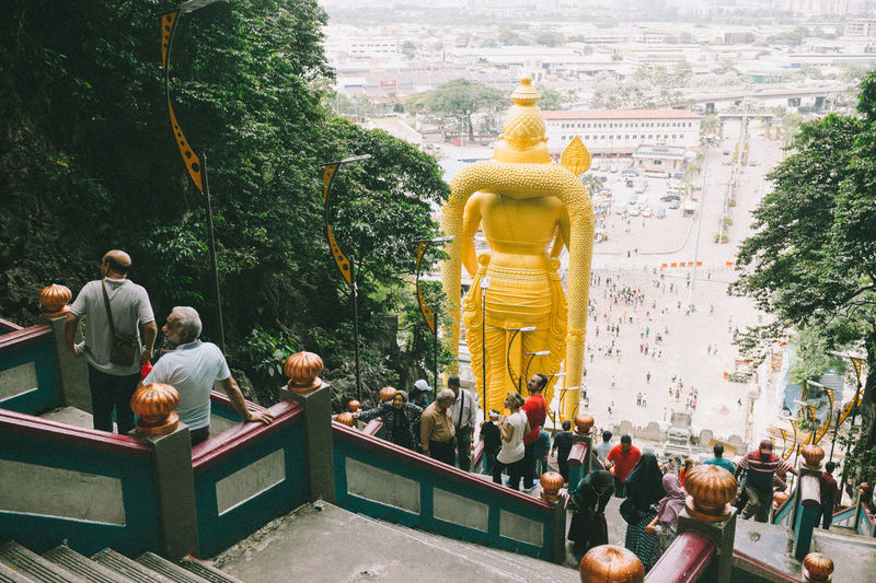 Step after step Architecture Batu Caves Built Structure Day Fujifilm_xseries Golden Color Human Representation Large Group Of People Lifestyles Male Likeness Men Outdoors People Place Of Worship Real People Religion Sculpture Sky Spirituality Statue Travel Destinations Tree VSCO