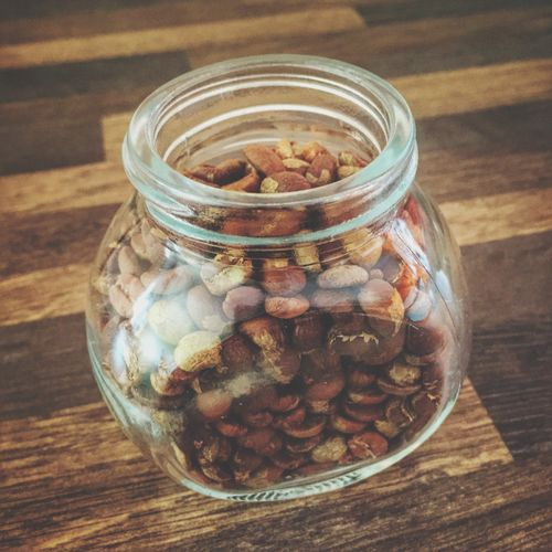 High angle view of roasted coffee beans in jar on table