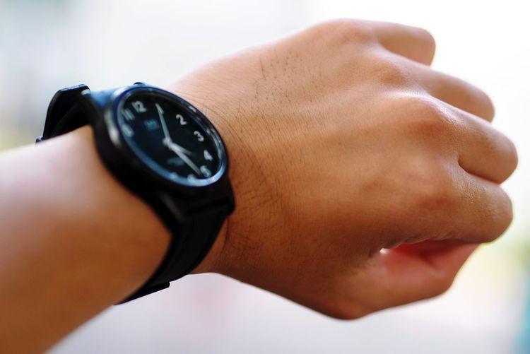 Close-Up Of Human Hand Wearing Wristwatch