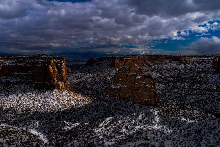 Long shadows at the Colorado Monument Beauty In Nature Cloud - Sky Day Extreme Terrain Landscape Nature No People Outdoors Physical Geography Rock - Object Scenics Sky Travel Destinations