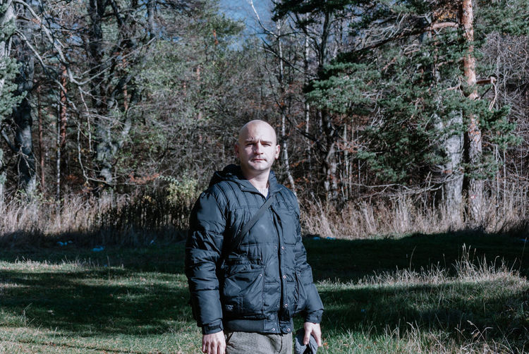 Portrait Of Bald Man Standing In Park