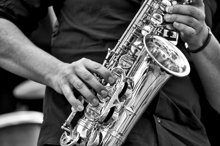 Close-up of man playing trumpet outdoors