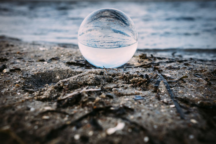 Crystal Ball Reflection Beach Close-up Crystal Ball Day Nature No People Outdoors Sand Selective Focus Water
