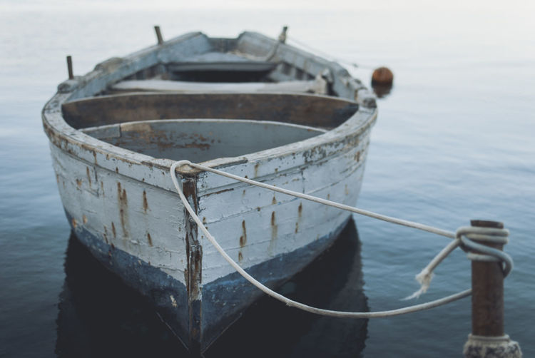 Close-up of fishing boat moored in sea