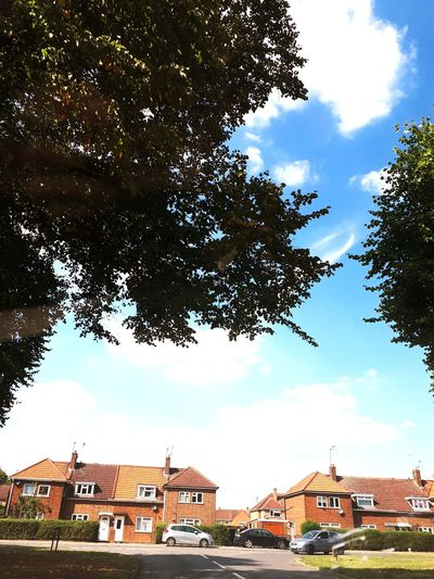 Sunny day in United Kingdom Blue Sky Brick Houses Street Photography U.K Corby Tree City Cityscape Place Of Worship Roof House Residential Building Religion Sky Architecture TOWNSCAPE Roof Tile Townhouse Rooftop Residential Structure Village Old Town Town Country House
