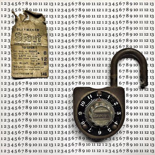 Close-up of padlock on numbered sheet