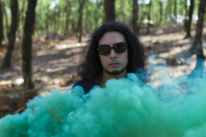 Smoky Portrait Glasses Green Green Color Grenade Hair Man Nature Smoke Sunlight TheWeekOnEyeEM Boy Colorful Day Fog Front View Hairstyle Long Hair One Person Outdoors Park Portrait Sun Sunglasses Tree Young Adult