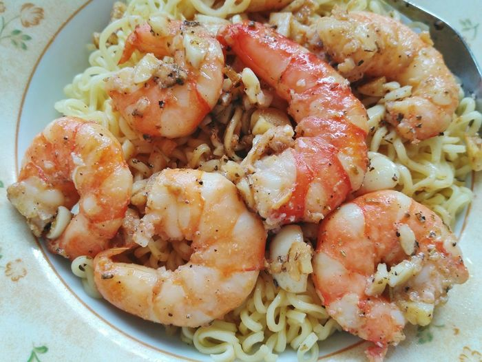 Close-Up Of Pasta Prawns In Plate