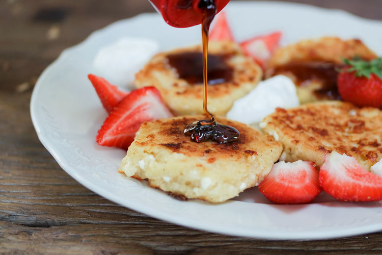 Cottage cheese pancakes with strawberries, yoghurt and caramel syrup. Perfect lazy Sunday morning breakfast Food And Drink Food Fruit Freshness Plate Ready-to-eat Healthy Eating Close-up Berry Fruit No People Table Red Strawberry Still Life Indoors  Wellbeing Vegetable Indulgence Serving Size Breakfast Temptation Garnish Pancakes Pancake Cottage Cheese Cottage Cheese Pancakes Yoghurt And Fruit Sugar Caramel Sauce Delicious Sweet Dairy Product Baked Goods Home Made Food Homemade Pancakes Lazy Sunday Comfy And Cozy Comfort Food Protein Fat
