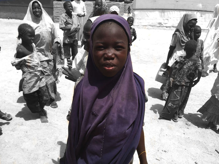 Young girl in IDP Camp in Maiduguri, Nigeria. Victim of Boko Haram Boys Child Childhood Day Girl Girls Leisure Activity Lifestyles Men Outdoors Real People Refugee Sand Young Adult Camp The Photojournalist - 2018 EyeEm Awards