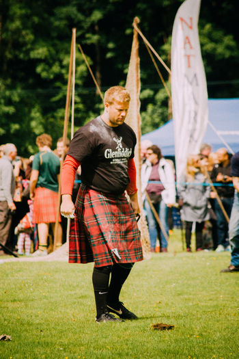 Highland Games Holding Kilt Leisure Activity Lifestyles Men Real People Scotland Standing Young Adult