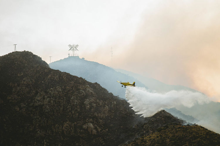 Beauty In Nature Day EyeEm Best Shots EyeEm Gallery EyeEmBestPics Fire Firefighter Firefighters In Action Fly Fog Landscape Mountain Mountain Range Mountains Nature No People Outdoors Plane