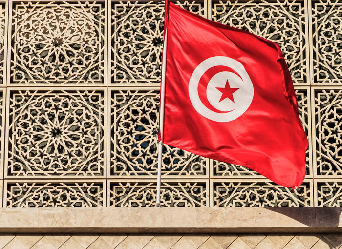 Tunisian flag. Tunisian Flag Wall Architecture Flag No People Patriotism Pattern Red Star Shape